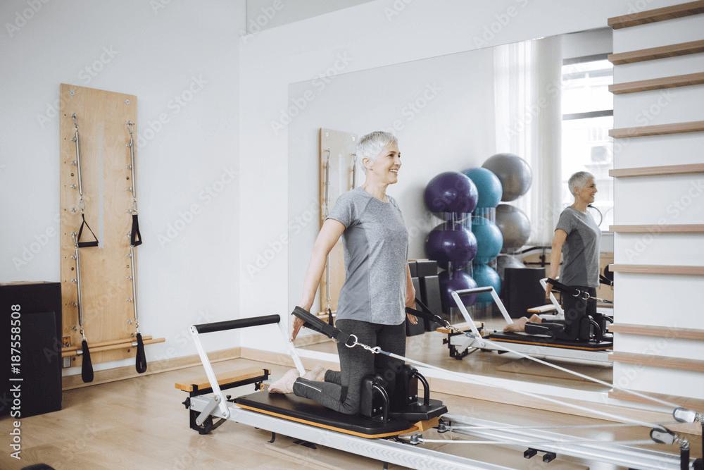 Elder women doing beginner Reformer Pilates
